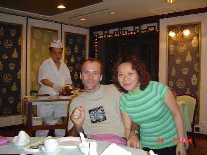 My wife Carol and I enjoying a very tasty dinner at a Peking Duck restaurant in Hong Kong.